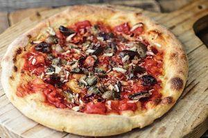 Mandorle, capperi sotto sale, olive taggiasche, pomodorini, aglio e origano
